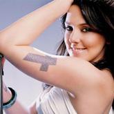 Mel C harta de sus tatuajes