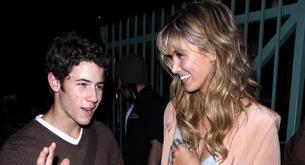 Nick Jonas y Delta Goodrem en el concierto de Adele